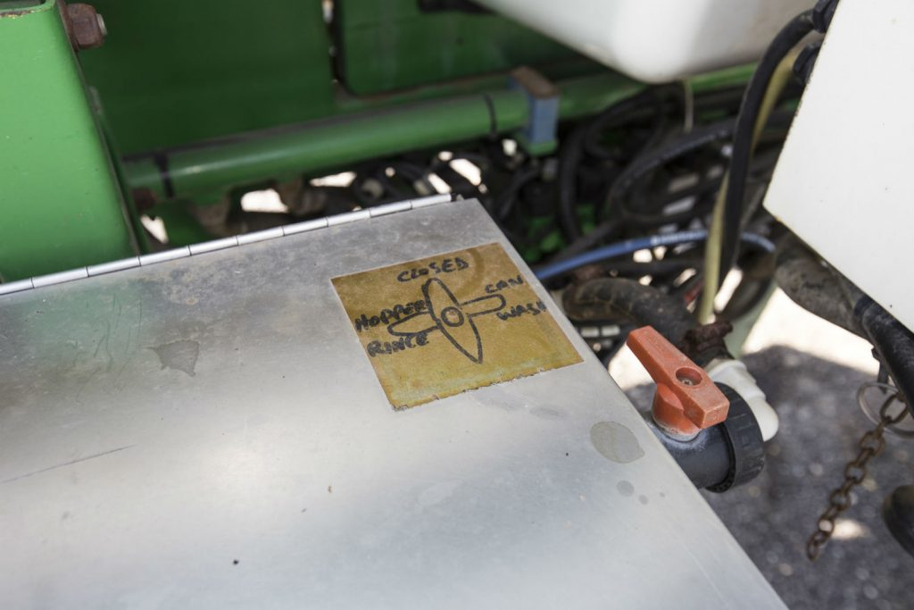 Illegible control labels on a sprayer